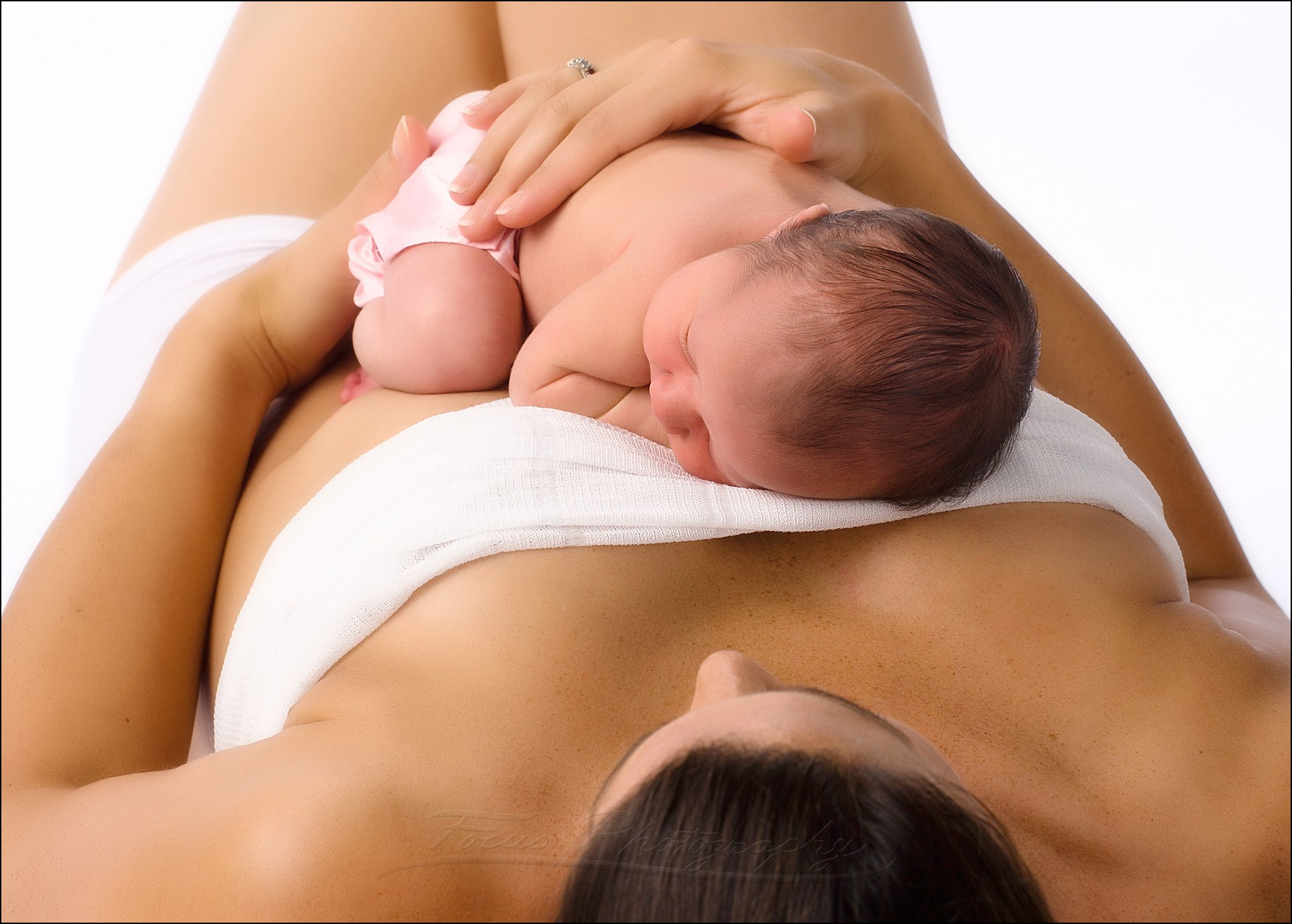 newborn family photography image of baby on mother's chest