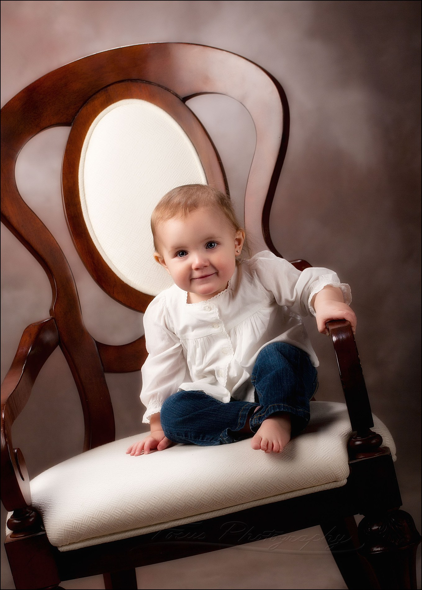 1 year old sits up in chair on own