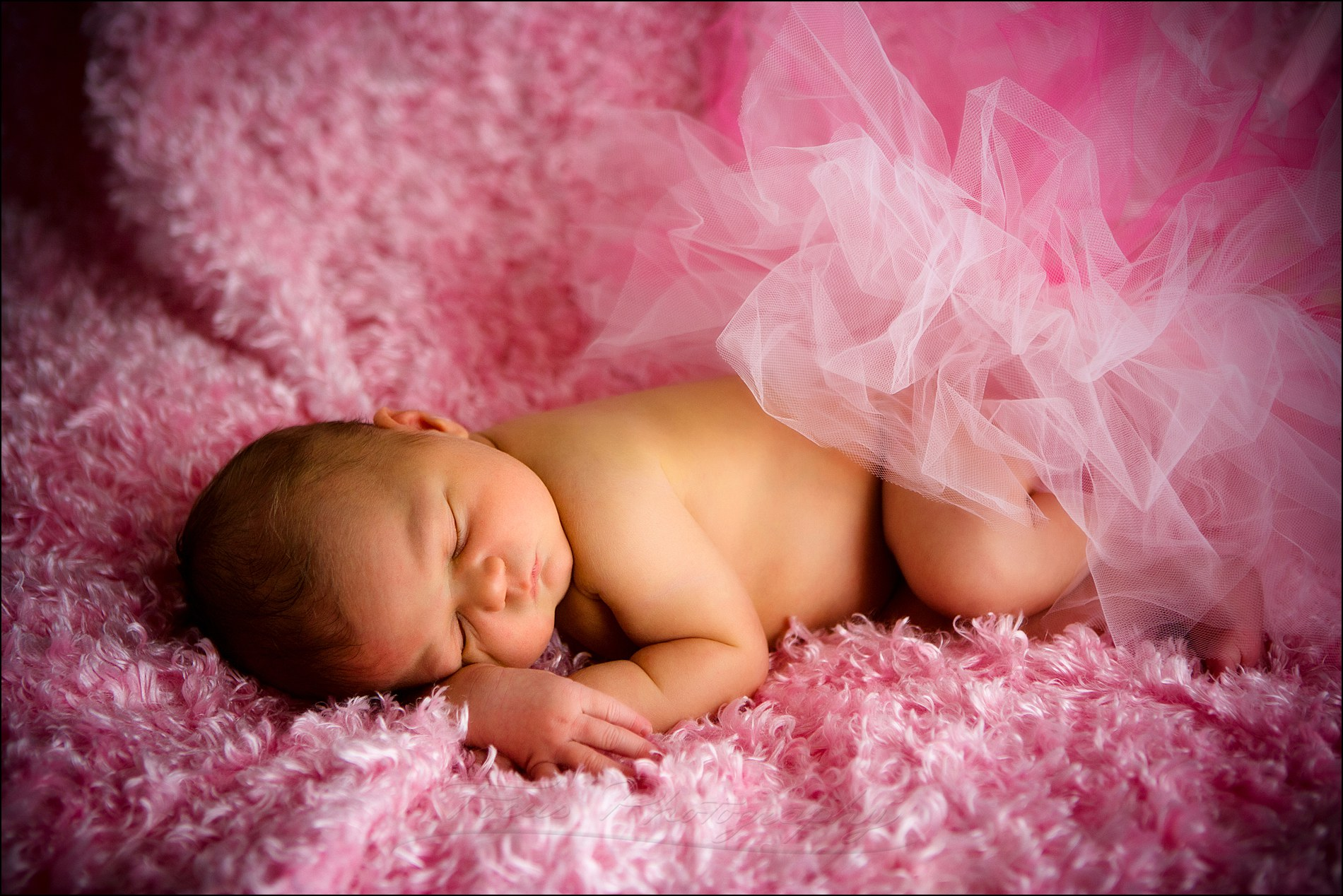 baby girl on pink fur with tutu