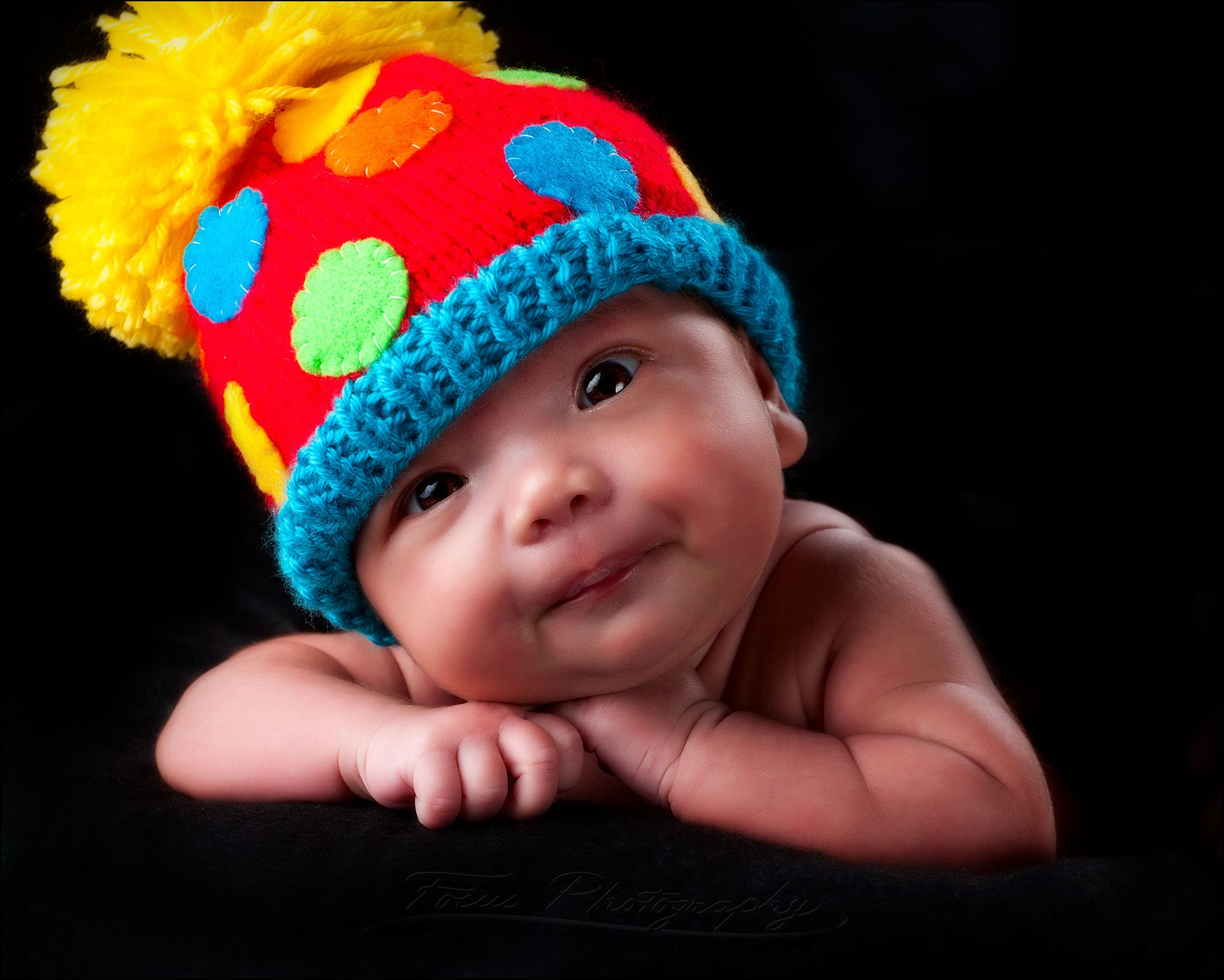 baby boy and colorful hat