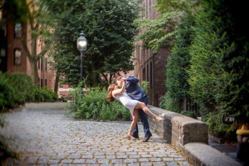 a dip under a streetlamp during an engagement photoshoot in boston's north end.