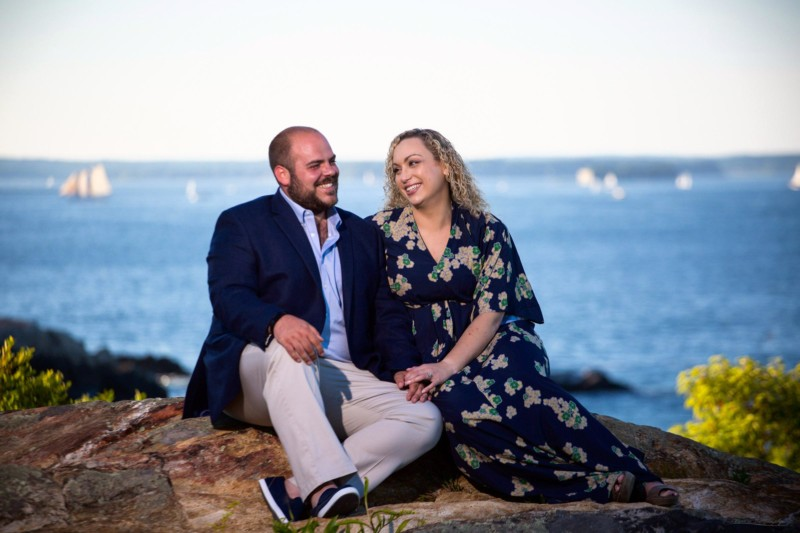 couple on rocks in front of ocean for engagement pictures at Fort Williams Park in Cape Elizabeth