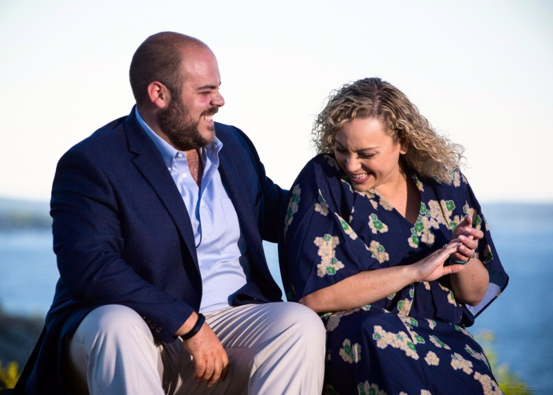 laughing couple in Maine engagement pictures at Fort Williams Park in Cape Elizabeth
