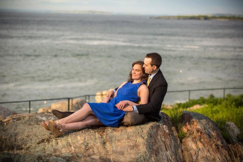 couple on rocks during Maine engagement photoshoot