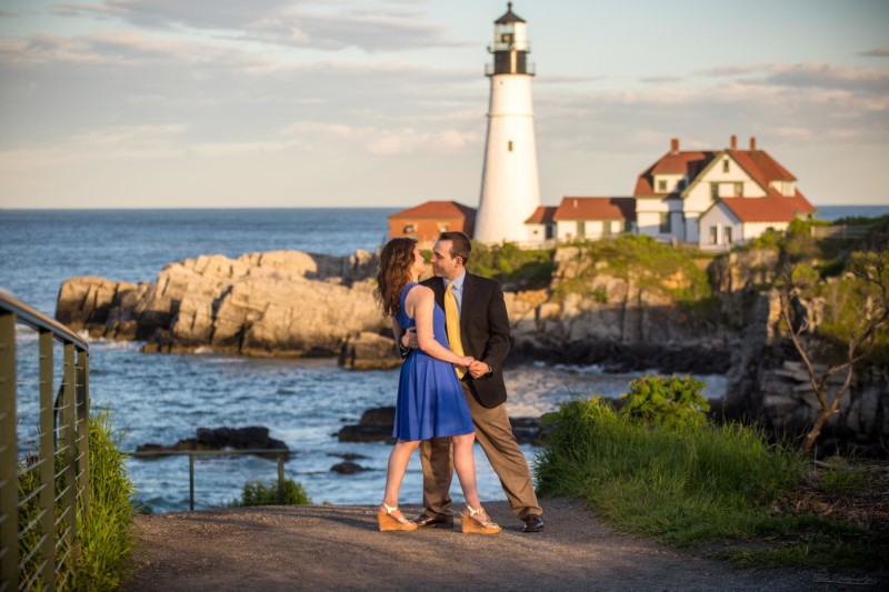 a kiss in front of the lighthouse