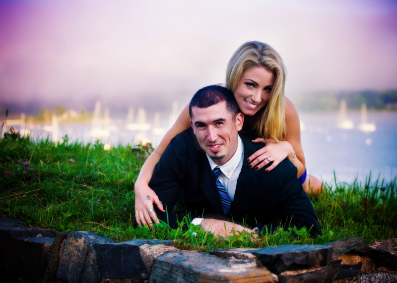 engaged couple on the grass at ocean
