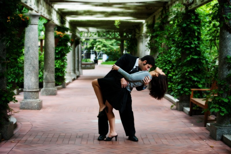 post office square in boston with couple dancing during engagement photoshoot