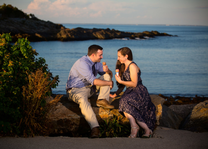 couple eats ice cream at ogunquit beach engagement photoshoot