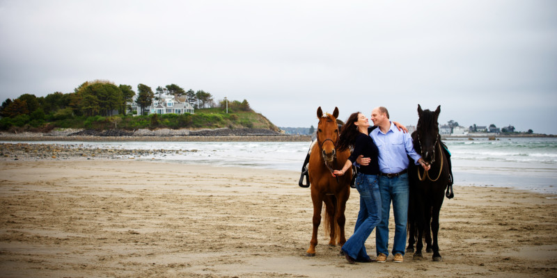 horses on sand beach for engagement photoshoot in kennebunkport, maine