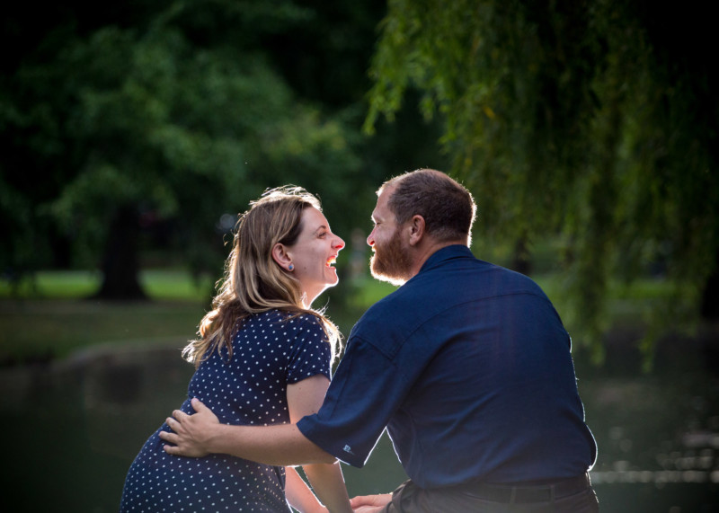 couple lit from behind in boston public garden engagement photos