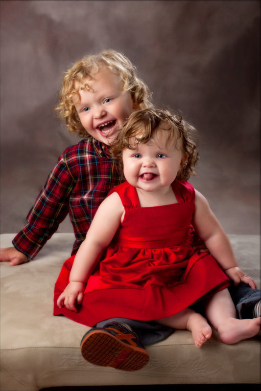bother and baby sister in red for family photos