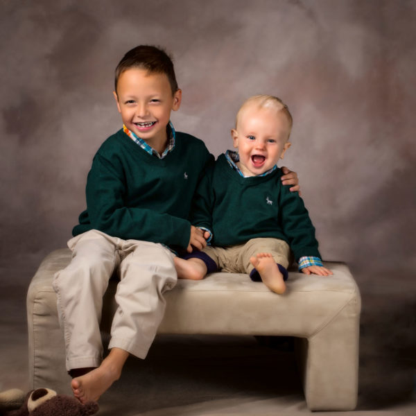 brothers wearing green on brown backgound