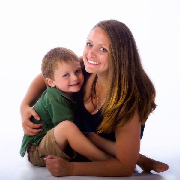 son clings to mom in great mother/son photo at maine photography studio