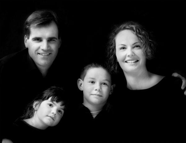 low key black and white family photo