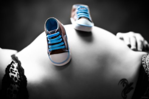 sneakers walking down pregnant belly