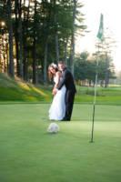Groom helping bride putt at Dunegrass wedding