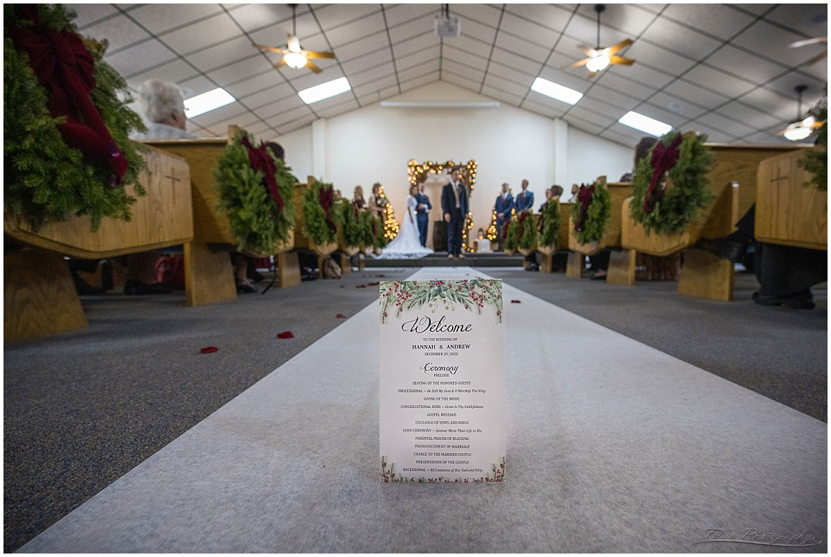 invite in aisle of church wedding