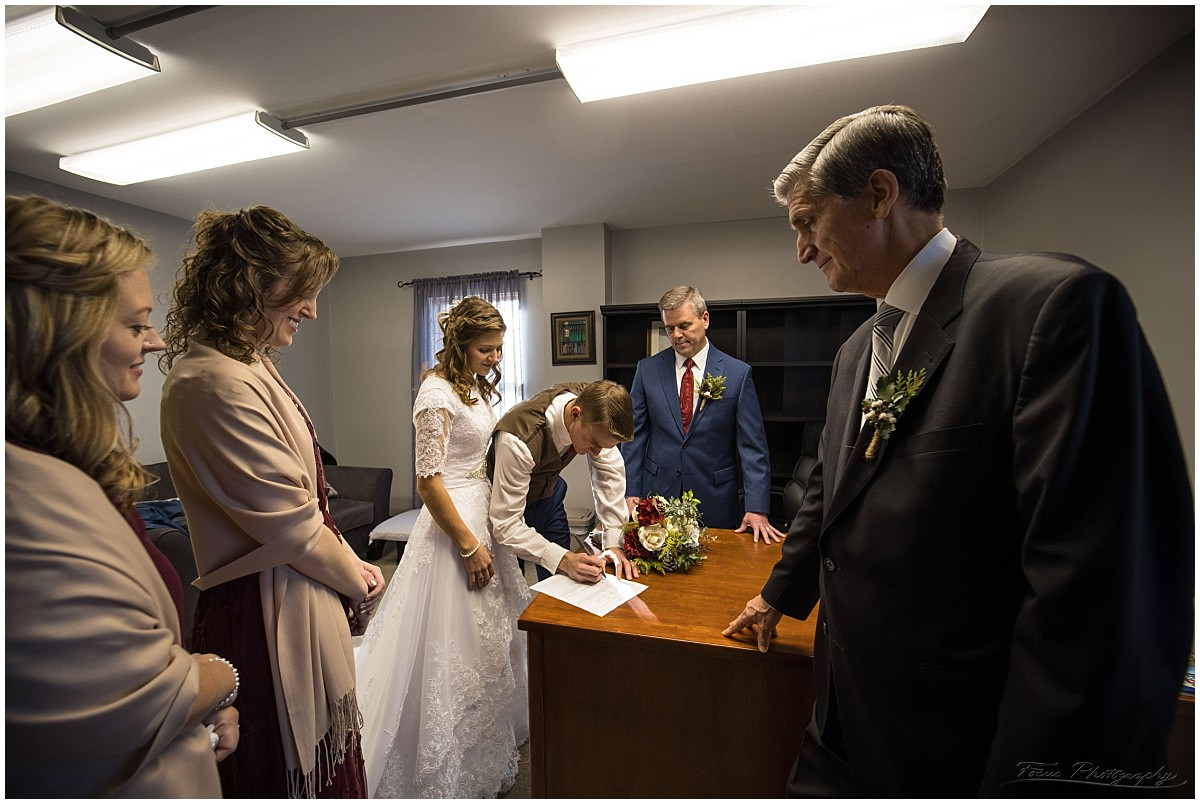 The signing of the marriage license