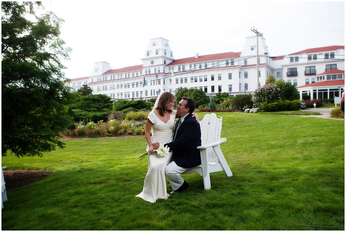wedding couple with Wentworth by the Sea in background