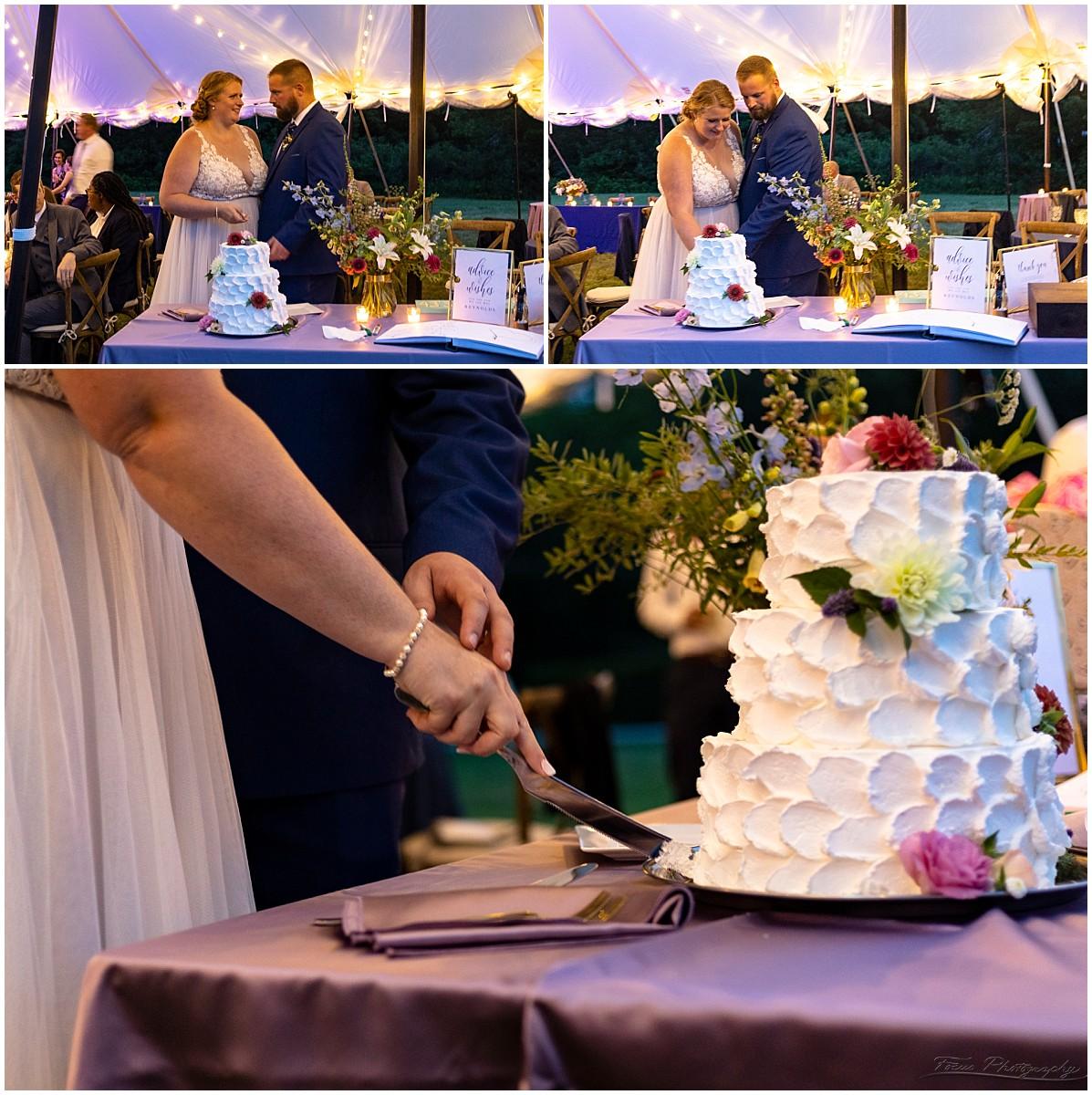 cutting the cake at backyard wedding reception in North Yarmouth