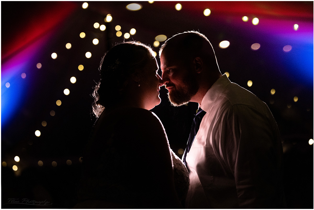 Bride and groom in the tent at end of night