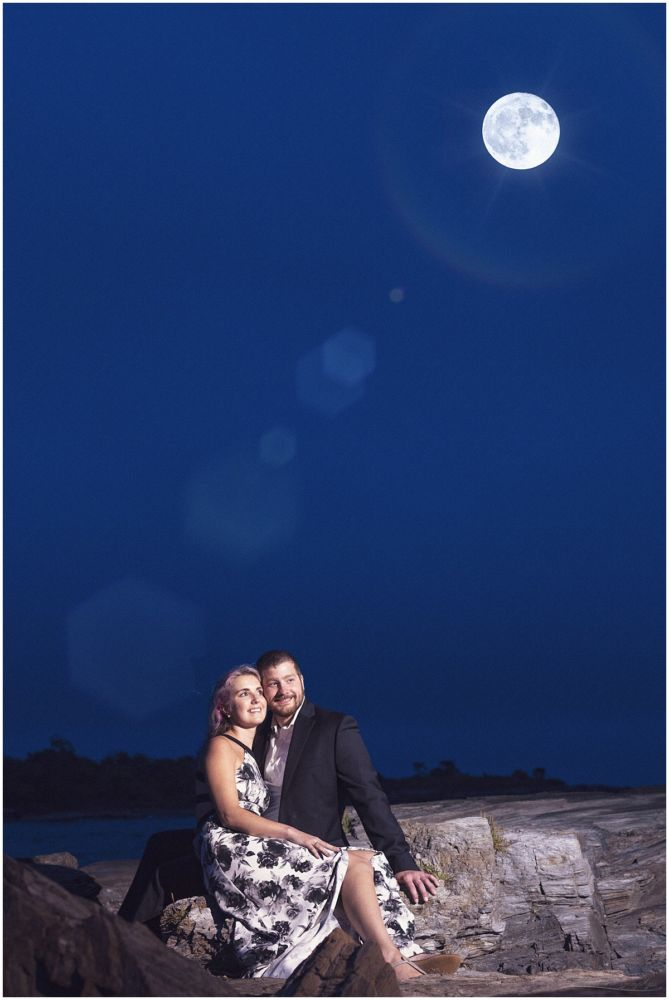 Moon over engaged couple in maine photo shoot