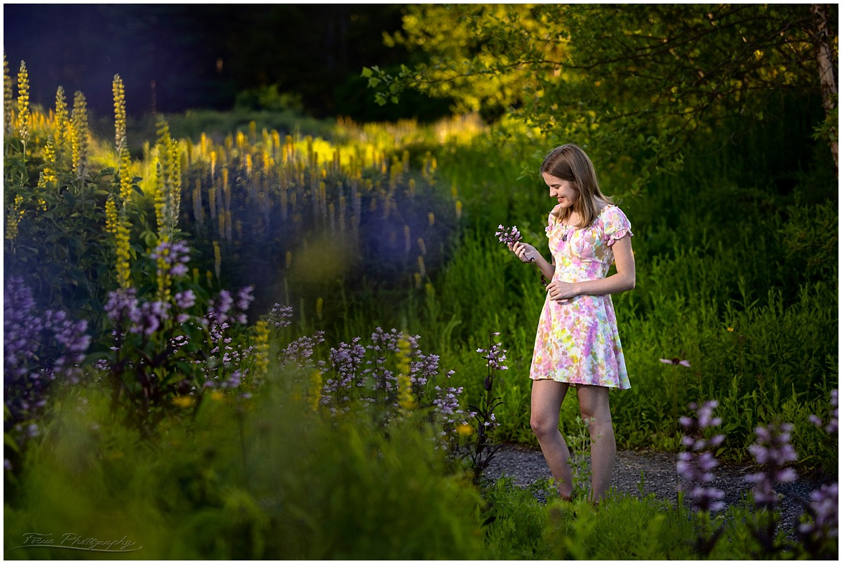 senior girl photographed in the flower gardens at Fort Williams,