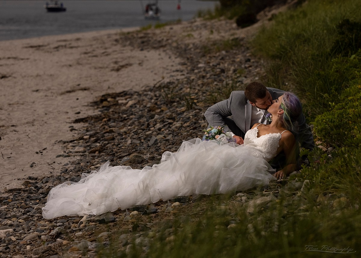 bride and groom on beach at drake's island