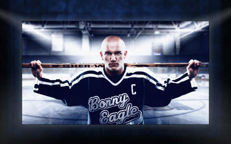 award-winning picture of high school senior wearing hockey jersey in front of ice rink