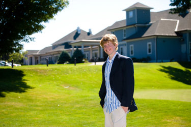 golfer photographed at portland country club for unique senior picture in maine