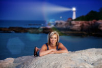 senior pictures at fort williams in evening with portland head light in background