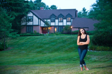 cheverus high school student photographed in front of her house for senior portrait