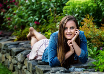 senior picture created on stone wall at her house in gorham, maine