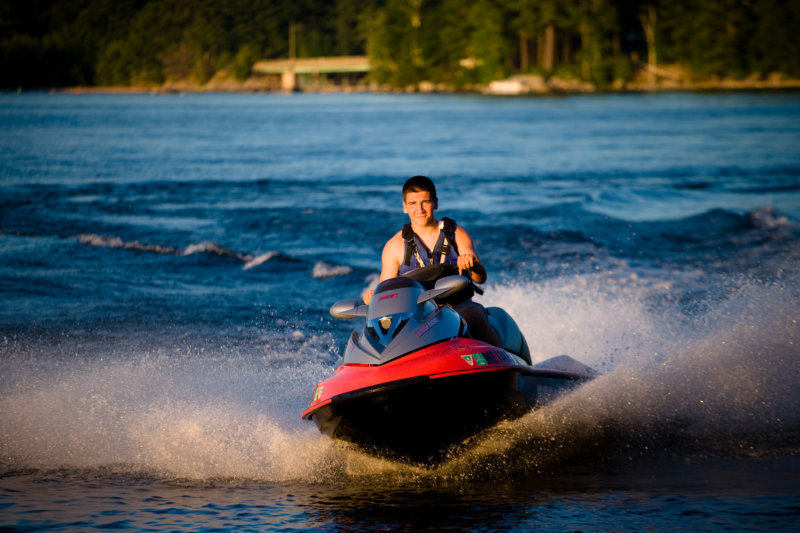 cheverus high school senior boy photographed on his jet ski on lake in maine