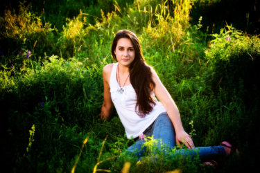 senior girl in wild grasses photographed at audubon center park in falmouth, maine