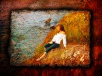 senior girl on rocks at maine shore for portrait