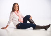 senior girl photographed on white in contemporary photo studio
