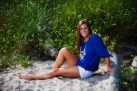 senior portrait at the beach in white sand