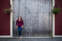 senior picture taken in front of barn doors at her house