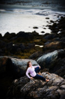 view of beach and rocks in senior picture taken at fort williams in cape elizabeth, maine