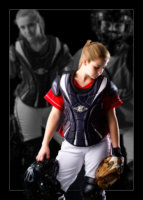 softball catcher photographed wearing uniform in maine photography studio for senior pictures