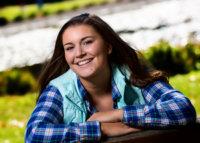 senior girl on park bench