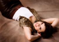senior girl wearing leopard scarf on brown background in studio in Westbrook