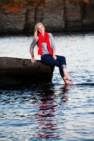 girl with red scarf at beach in maine for senior photos