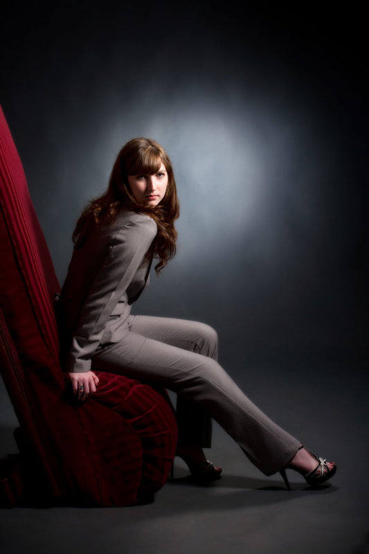 senior picture in studio of girl in grey suit