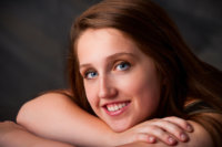 girl with blue eyes photographed in studio for senior pictures