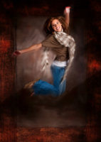girl jumps in air in photography studio