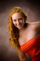 red haired girl in photography studio in maine