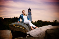 girl wearing white pants at beach in maine for senior pics