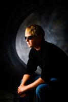 boy with sunglasses on in studio portrait in photo studio
